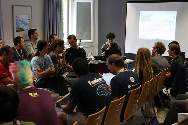 Picture of the  reproducible builds  roundtable during DebConf15